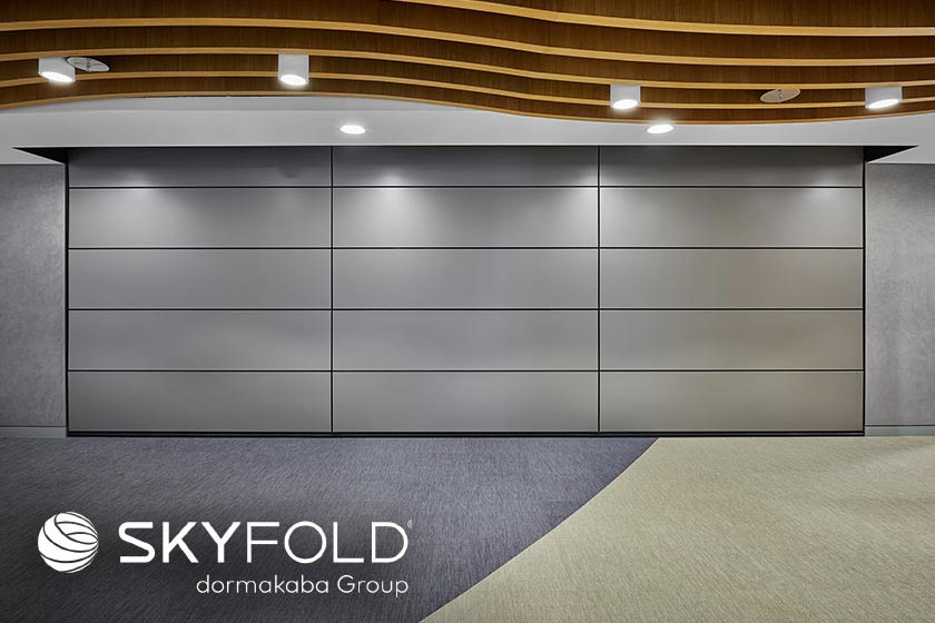 Skyfold - Vertical retractable walls that deliver superior acoustic performance. SkyFold is lightweight, easy to use, and stores right in your ceiling using automated deployment technology.